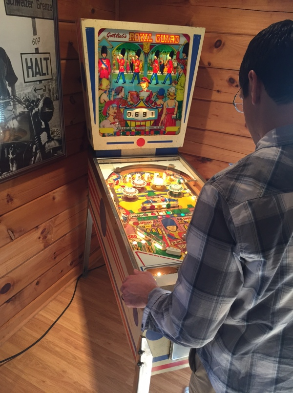 Tim's brother Terry playing a recently restored pinball machine from their childhood
